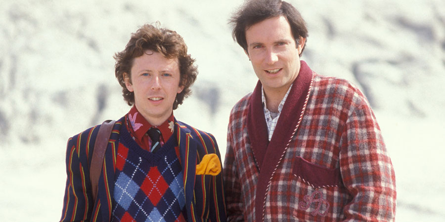 The Hitchhiker's Guide To The Galaxy. Image shows from L to R: Ford Prefect (David Dixon), Arthur Dent (Simon Jones). Copyright: BBC.