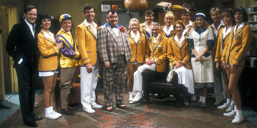 Hi-De-Hi!. Image shows from L to R: Sqdn-Ldr Clive Dempster DFC (David Griffin), Gladys Pugh (Ruth Madoc), Fred Quilly (Felix Bowness), Spike Dixon (Jeffrey Holland), Ted Bovis (Paul Shane), April Wingate (Linda Regan), Stanley Matthews (David Webb), Barry Stuart-Hargreaves (Barry Howard), Sylvia Garnsey (Nikki Kelly), Yvonne Stuart-Hargreaves (Diane Holland), Bruce Matthews (Tony Webb), Peggy Ollerenshaw (Su Pollard), Gary Bolton (Chris Andrews), Unknown, Dawn Freshwater (Laura Jackson). Copyright: BBC.