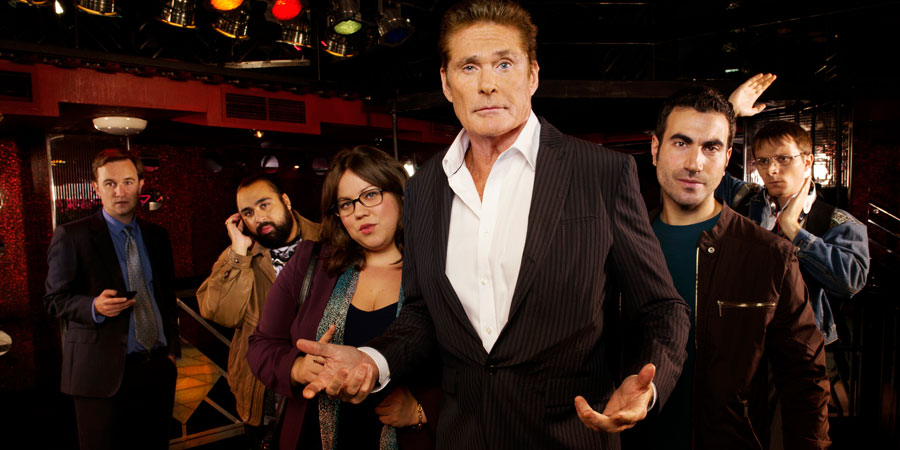 Hoff The Record. Image shows from L to R: Max Coleman (Fergus Craig), Terry Patel (Asim Chaudhry), Harriet Fitzgerald (Ella Smith), Hoff (David Hasselhoff), Danny Jones (Brett Goldstein), Dieter Hasselhoff (Mark Quartley). Copyright: Me & You Productions.