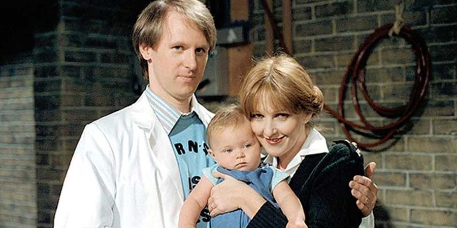 Holding The Fort. Image shows from L to R: Russell Milburn (Peter Davison), Unknown, Penny Milburn (Patricia Hodge). Copyright: London Weekend Television.