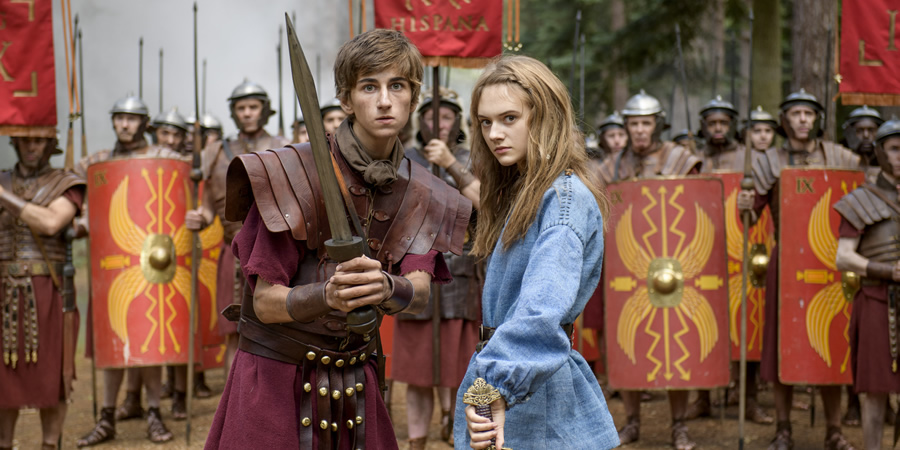 Horrible Histories: The Movie - Rotten Romans. Image shows from L to R: Atti (Sebastian Croft), Orla (Emilia Jones). Copyright: Nick Wall.