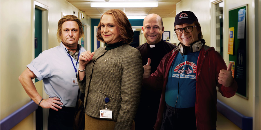 Hospital People. Image shows from L to R: Ian D Montfort (Tom Binns), Susan Mitchell (Tom Binns), Father Kenny (Tom Binns), Ivan Brackenbury (Tom Binns). Copyright: Roughcut Television.