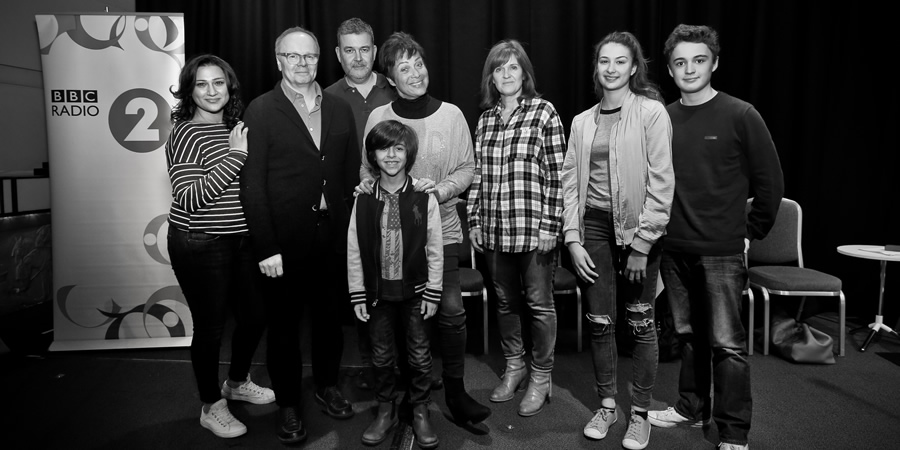 Just Grand. Image shows from L to R: Padma (Chetna Pandya), Frank (Jason Watkins), Thommo (Phil Mealey), Gloria (Denise Welch), Marcus (Ben Greaves-Neal), Sandra (Siobhan Finneran), Poppy (Kate Sale), Ollie (Toby Ungelson). Copyright: BBC.
