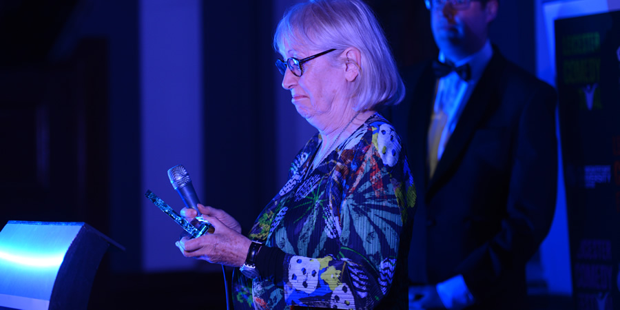 Victoria Wood's sister picking up the comedian's Legend Of Comedy Award at the Leicester Comedy Festival Awards 2017. Rosalind Watson. Copyright: Crosscut Media.
