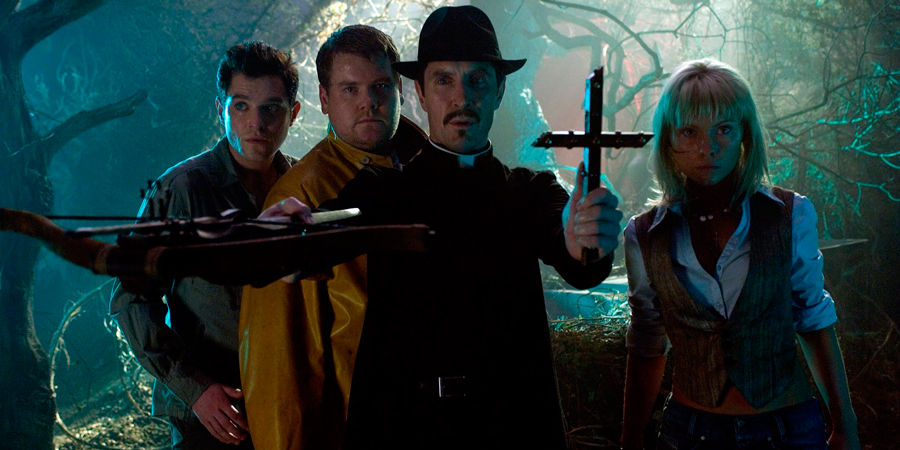 Lesbian Vampire Killers. Image shows from L to R: Jimmy (Mathew Horne), Fletch (James Corden), Vicar (Paul McGann), Lotte (MyAnna Buring). Copyright: Velvet Bite.
