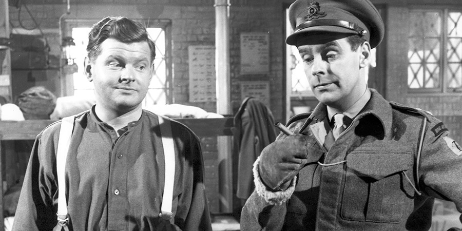 Light Up The Sky!. Image shows from L to R: Gunner Syd McCaffey (Benny Hill), Lt. Ogleby (Ian Carmichael).
