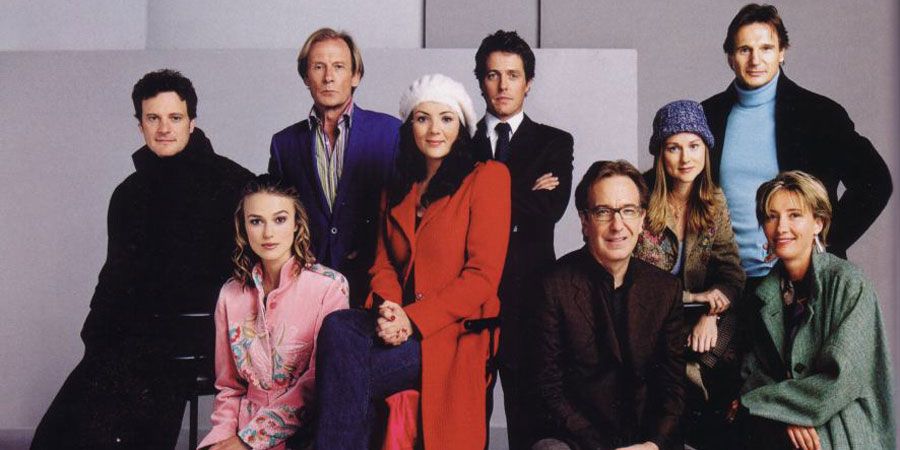Love Actually. Image shows from L to R: Jamie Bennett (Colin Firth), Juliet (Keira Knightley), Billy Mack (Bill Nighy), Natalie (Martine McCutcheon), Jamie Bennett (Colin Firth), Harry (Alan Rickman), Sarah (Laura Linney), Daniel (Liam Neeson), Karen (Emma Thompson). Copyright: Working Title Films.