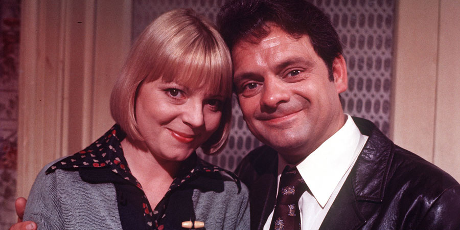 Lucky Feller. Image shows from L to R: Kathleen Peake (Cheryl Hall), Bernard 'Shorty' Mepstead (David Jason). Copyright: London Weekend Television.