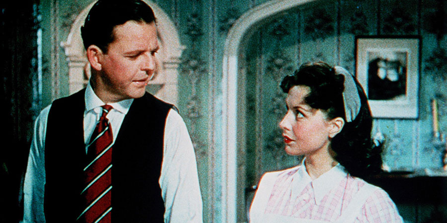 Made In Heaven. Image shows from L to R: Basil Topham (David Tomlinson), Marta (Sonja Ziemann). Copyright: ITV.