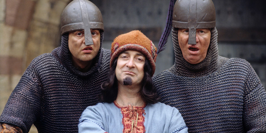 Maid Marian And Her Merry Men. Image shows from L to R: Gary (Mark Billingham), The Sheriff of Nottingham (Tony Robinson), Graeme (David Lloyd). Copyright: BBC.