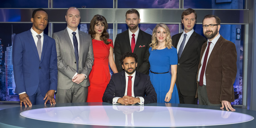 The Mash Report. Image shows from L to R: Jason Forbes, Newsreader Tom (Steve N Allen), Newsreader Susan (Ellie Taylor), Nish Kumar, Pierre Novellie, Rachel / Emma (Rachel Parris), Andrew Hunter Murray, Greig Johnson. Copyright: Princess Productions.