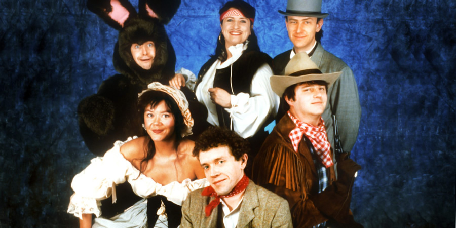 The Masterson Inheritance. Image shows from L to R: Phelim McDermott, Josie Lawrence, Jim Sweeney, Caroline Quentin, Lee Simpson, Paul Merton. Copyright: BBC.