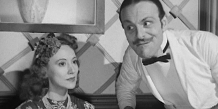 Melody Club. Image shows from L to R: Cora (Lilian Grey), Freddy Forrester (Terry-Thomas). Copyright: Tempean Films.