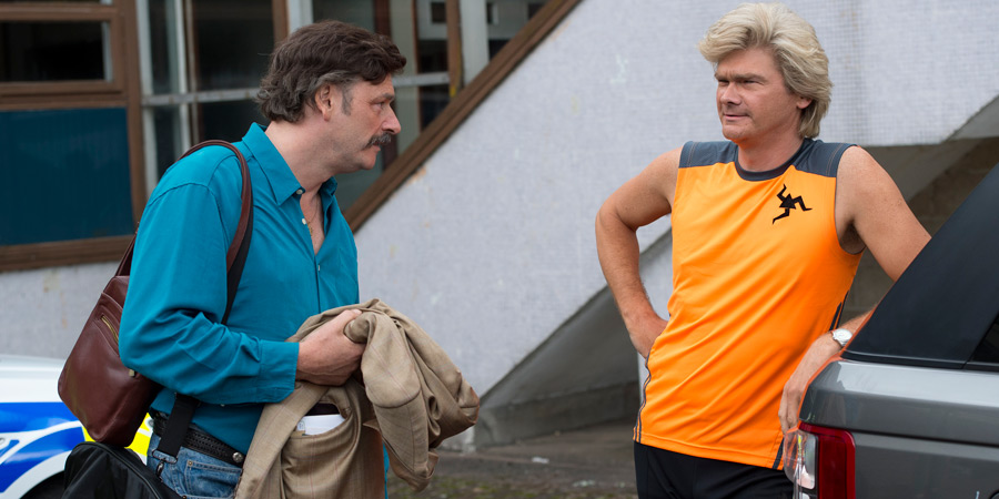 Mindhorn. Image shows from L to R: Richard 'Mindhorn' Thorncroft (Julian Barratt), Clive Parnevik (Simon Farnaby). Copyright: Studio Canal.