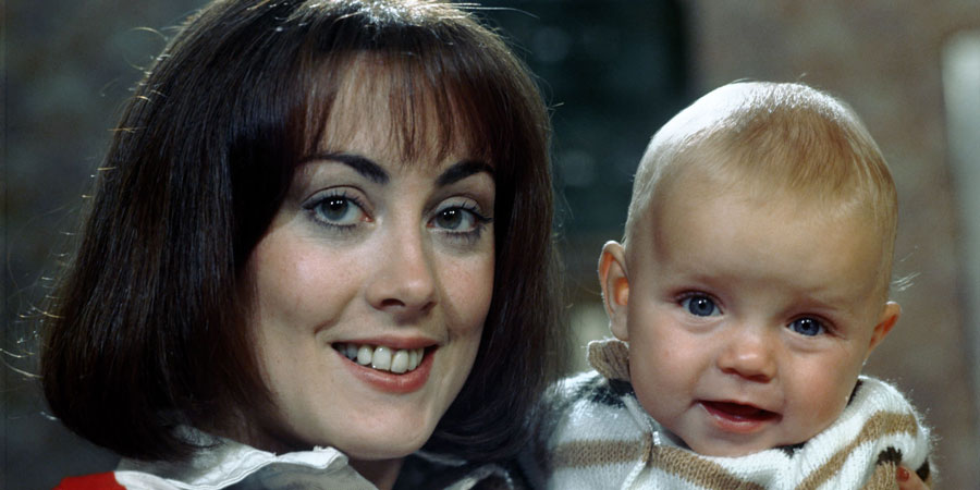 Miss Jones And Son. Image shows from L to R: Elizabeth Jones (Paula Wilcox), Baby Roland (Luke Steensil). Copyright: Thames Television.