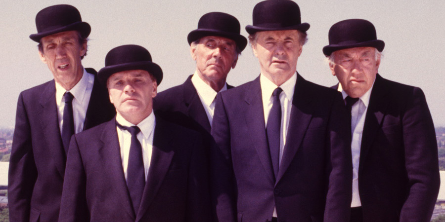 Photograph courtesy of Revelation Films. Image shows from L to R: Dozy Undertaker (Eli Woods), Short Undertaker (Freddie Starr), Senior Undertaker (Eric Sykes), Tall Undertaker (Henry McGee), Elderly Undertaker (Bob Todd). Copyright: Thames Television.