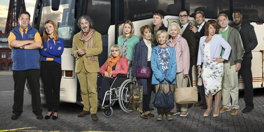 Murder On The Blackpool Express. Image shows from L to R: Terry (Johnny Vegas), Gemma (Sian Gibson), David Van Der Clane (Griff Rhys Jones), Moira (Nina Wadia), Laura (Kimberley Nixon), Peggy (Una Stubbs), Graham (Mark Heap), Mildred (Sheila Reid), Marge (Susie Blake), Kevin (Kevin Eldon), Doc (Nigel Havers), Grace (Katy Cavanagh), George (Matthew Cottle), Ben (Javone Prince).
