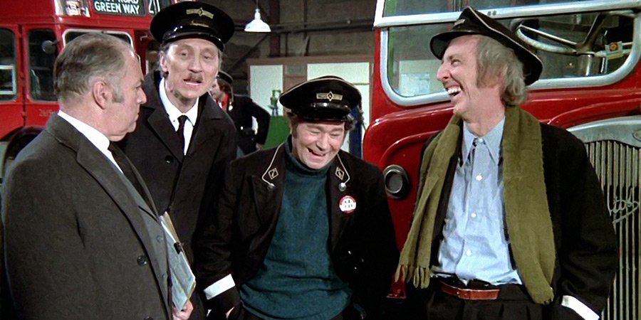 Mutiny On The Buses. Image shows from L to R: Mr. Jenkins (Kevin Brennan), Inspector Cyril 'Blakey' Blake (Stephen Lewis), Stan Butler (Reg Varney), Jack Harper (Bob Grant). Copyright: Studio Canal.