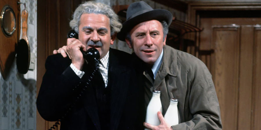 Never Mind The Quality, Feel The Width. Image shows from L to R: Emmanuel 'Manny' Cohen (John Bluthal), Patrick Kelly (Joe Lynch). Copyright: Thames Television / ABC Television.