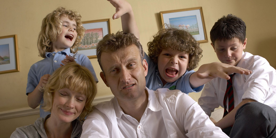 Outnumbered. Image shows from L to R: Karen (Ramona Marquez), Sue (Claire Skinner), Pete (Hugh Dennis), Ben (Daniel Roche), Jake (Tyger Drew-Honey). Copyright: Hat Trick Productions.