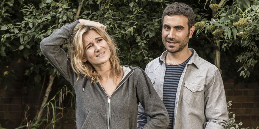 The Pact. Image shows from L to R: Amy Watson (Sarah Solemani), Andy (Brett Goldstein). Copyright: BBC.