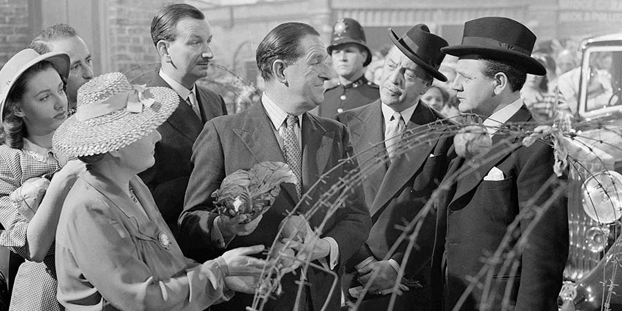 Passport To Pimlico. Image shows from L to R: Mr. P.J. Wix (Raymond Huntley), Arthur Pemberton (Stanley Holloway), Gregg (Basil Radford), Straker (Naunton Wayne). Copyright: Ealing Studios / Studio Canal.