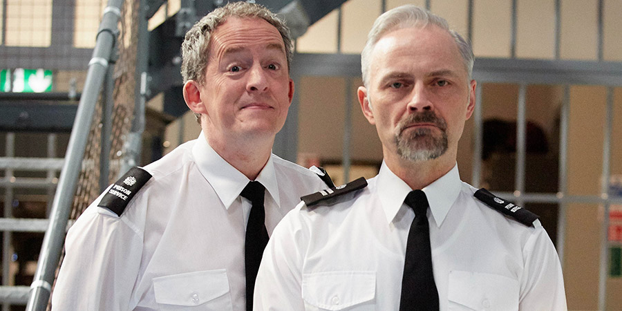 Porridge. Image shows from L to R: Officer Braithwaite (Dominic Coleman), Officer Meekie (Mark Bonnar). Copyright: BBC.