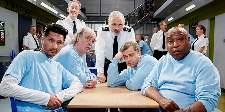Porridge. Image shows from L to R: Aziz (Harman Singh), Officer Braithwaite (Dominic Coleman), Joe Lotterby (Dave Hill), Officer Meekie (Mark Bonnar), Fletch (Kevin Bishop), Shel (Jason Barnett). Copyright: BBC.