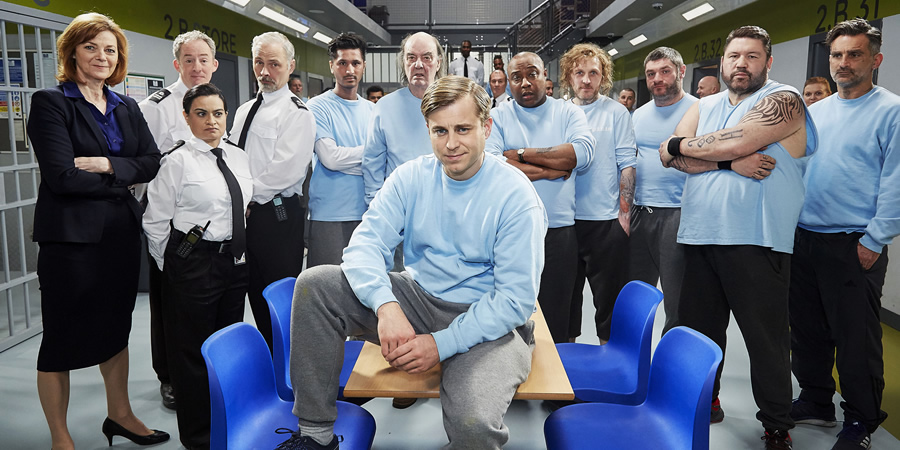 Porridge. Image shows from L to R: Culhane (Caolan Byrne), Officer Braithwaite (Dominic Coleman), Officer Driscoll (Amina Zia), Officer Meekie (Mark Bonnar), Aziz (Harman Singh), Joe Lotterby (Dave Hill), Fletch (Kevin Bishop), Shel (Jason Barnett), Culhane (Caolan Byrne), Dougie Parfitt (Harry Peacock), Scudds (Ricky Grover), Nagid (John Marquez). Copyright: BBC.