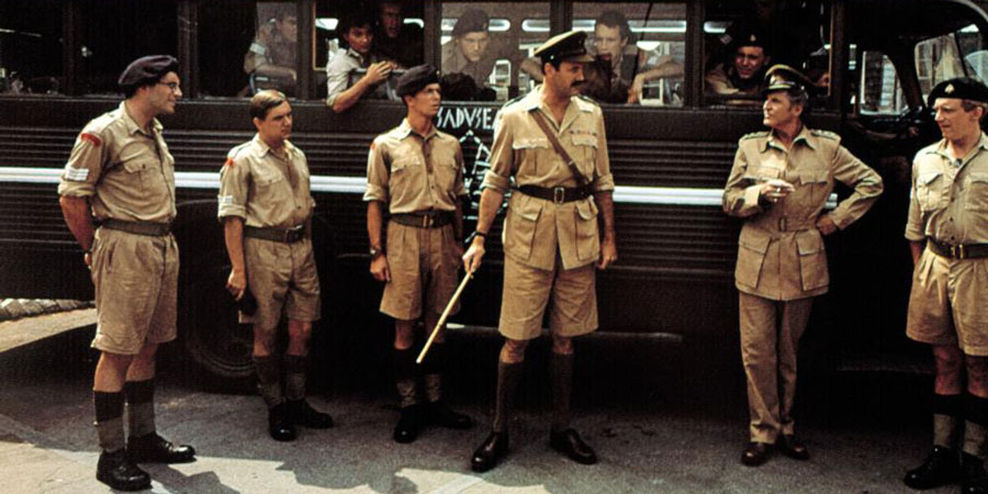 Privates On Parade. Image shows from L to R: Sergeant Eric Young-Love (Simon Jones), Sergeant Charles Bishop (David Bamber), Sergeant Steven Flowers (Patrick Pearson), Major Giles Flack (John Cleese), Acting Captain Terri Dennis (Denis Quilley), Unknown. Copyright: Hand Made Films.