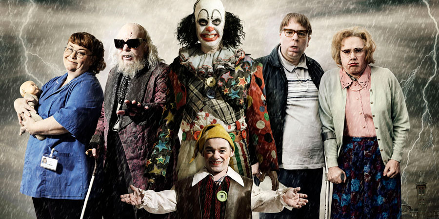 Psychoville. Image shows from L to R: Joy Aston (Dawn French), Oscar Lomax (Steve Pemberton), Robert Greenspan (Jason Tompkins), Mr Jelly (Reece Shearsmith), David Sowerbutts (Steve Pemberton), Maureen Sowerbutts (Reece Shearsmith). Copyright: BBC.