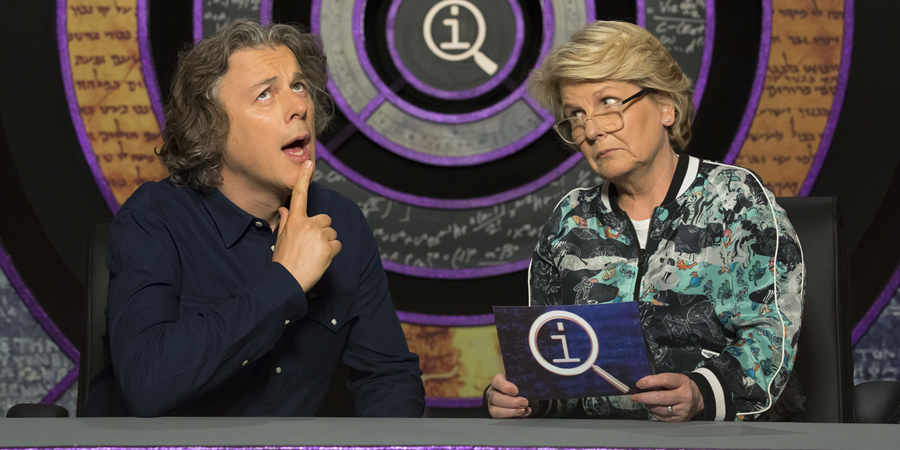 QI. Image shows from L to R: Alan Davies, Sandi Toksvig. Copyright: TalkbackThames.