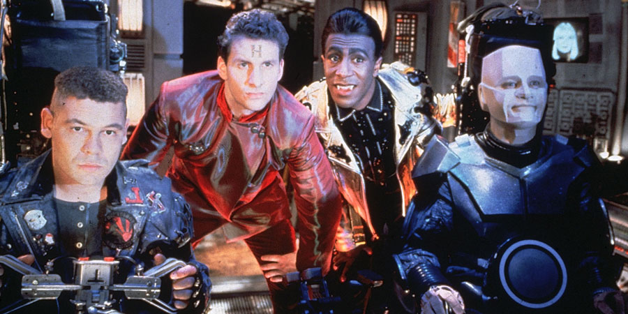 Red Dwarf. Image shows from L to R: Lister (Craig Charles), Rimmer (Chris Barrie), Cat (Danny John-Jules), Kryten (Robert Llewellyn), Holly (Hattie Hayridge). Copyright: Grant Naylor Productions / BBC.