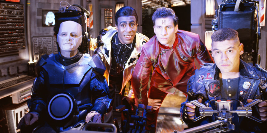 Red Dwarf. Image shows from L to R: Kryten (Robert Llewellyn), Cat (Danny John-Jules), Rimmer (Chris Barrie), Lister (Craig Charles). Copyright: BBC.