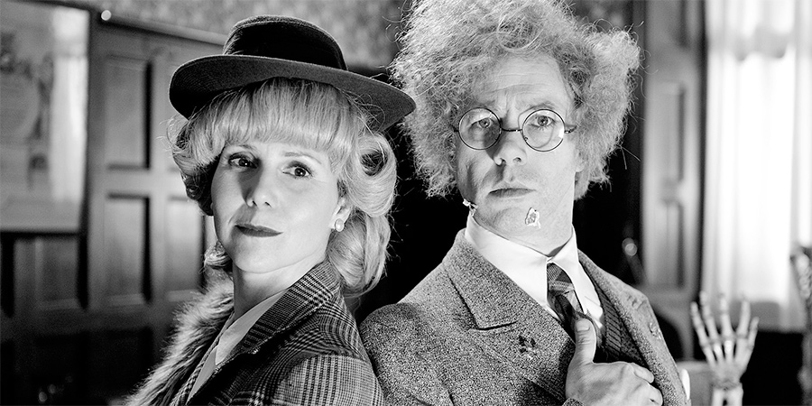 Reece Shearsmith In The Case Of The High Foot. Image shows from L to R: Hilda Stolf (Sally Phillips), Doctor (Reece Shearsmith). Copyright: Pett Productions.
