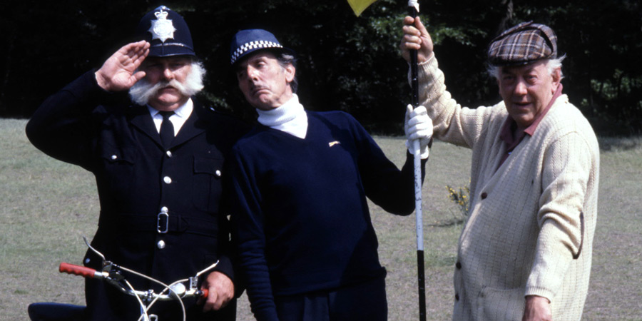 Photograph courtesy of Revelation Films. Image shows from L to R: Police Constable (Jimmy Edwards), Inspector Rhubarb (Eric Sykes), Vicar (Bob Todd). Copyright: Thames Television.