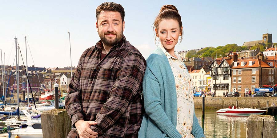 Scarborough. Image shows from L to R: Mike (Jason Manford), Karen (Catherine Tyldesley). Copyright: BBC Studios.