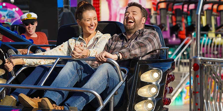 Scarborough. Image shows from L to R: Karen (Catherine Tyldesley), Mike (Jason Manford). Copyright: BBC Studios.