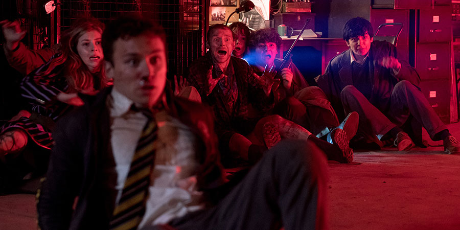 Slaughterhouse Rulez. Image shows from L to R: Clemsie Lawrence (Hermione Corfield), Don Wallace (Finn Cole), Meredith Houseman (Simon Pegg), Wootton (Kit Connor), Willoughby Blake (Asa Butterfield). Copyright: Sony Pictures.