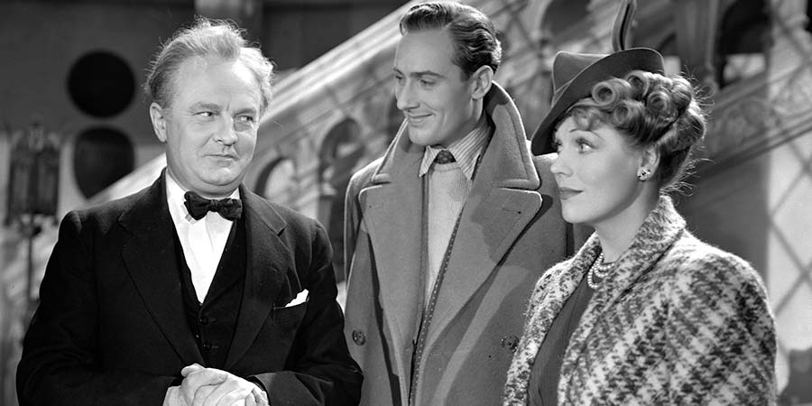 "Spring Meeting. Image shows from L to R: James, the Butler (Basil Sydney), Tony Fox-Collier (Michael Wilding), ""Tiny"" Peto (Enid Stamp-Taylor). Copyright: Associated British Picture Corporation."