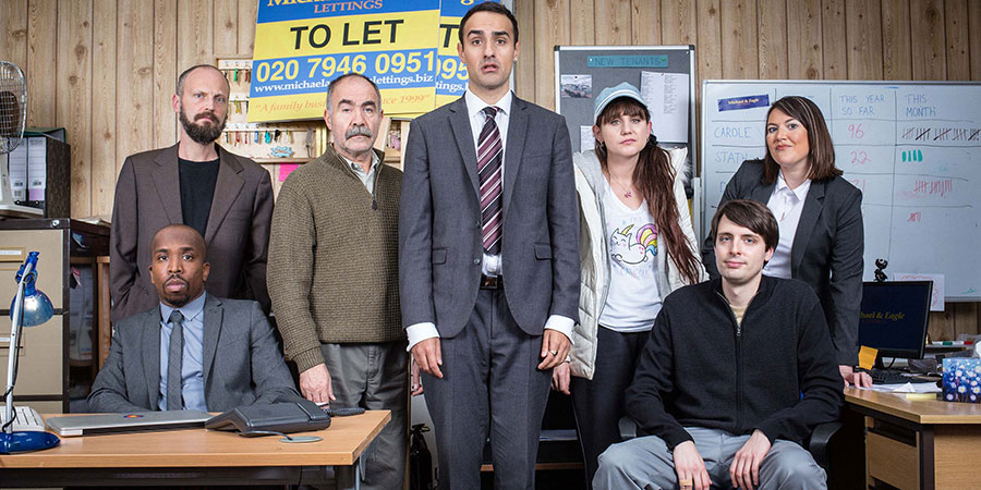 Stath Lets Flats. Image shows from L to R: Dean (Kiell Smith-Bynoe), Marcus (Alex Beckett), Vasos (Christos Stergioglou), Stath (Jamie Demetriou), Sophie (Natasia Demetriou), Al (Alastair Roberts), Carole (Katy Wix). Copyright: Roughcut Television.