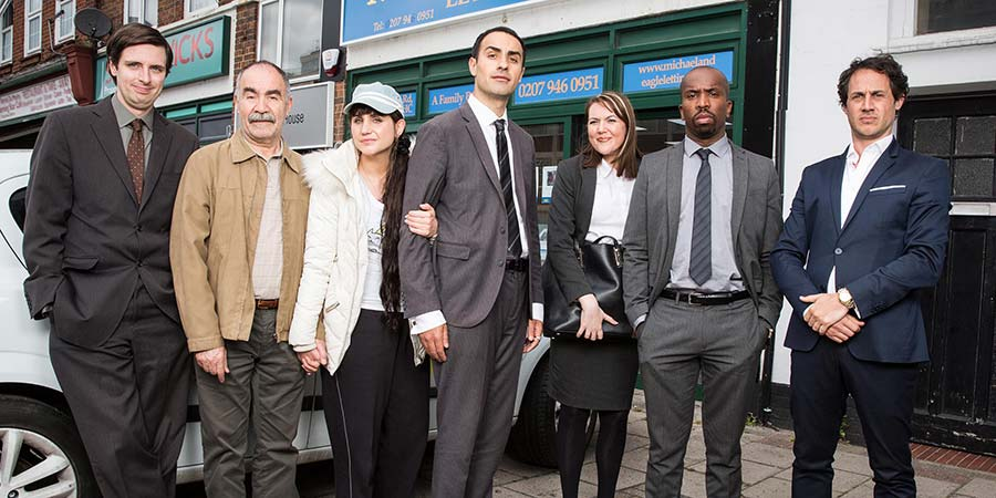 Stath Lets Flats. Image shows from L to R: Al (Alastair Roberts), Vasos (Christos Stergioglou), Sophie (Natasia Demetriou), Stath (Jamie Demetriou), Carole (Katy Wix), Dean (Kiell Smith-Bynoe), Julian (Dustin Demri-Burns). Copyright: Roughcut Television.