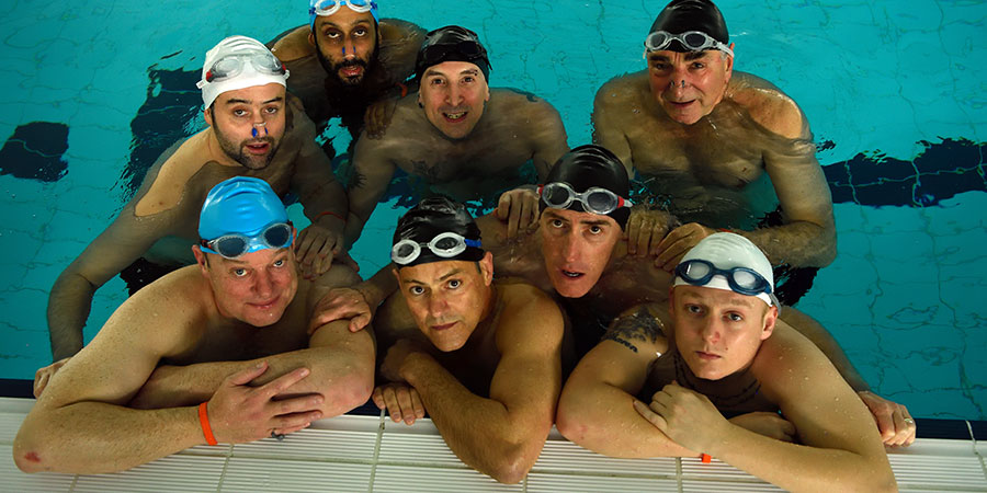Swimming With Men. Image shows from L to R: Colin (Daniel Mays), New Guy (Ronan Daly), Kurt (Adeel Akhtar), Luke (Rupert Graves), Silent Bob (Chris Jepson), Eric (Rob Brydon), Ted (Jim Carter), Tom (Thomas Turgoose). Copyright: Met Film.