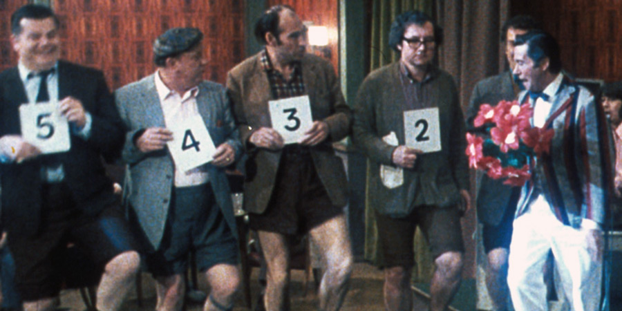 The Best Pair Of Legs In The Business. Image shows from L to R: Unknown, Unknown, Unknown, Unknown, Sherry (Reg Varney). Copyright: Sunny Productions.