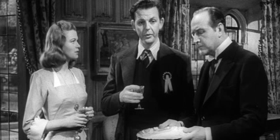 The Chiltern Hundreds. Image shows from L to R: June Farrell (Helen Backlin), Tony, Viscount Pym (David Tomlinson), Benjamin Beecham (Cecil Parker). Copyright: Two Cities Films.