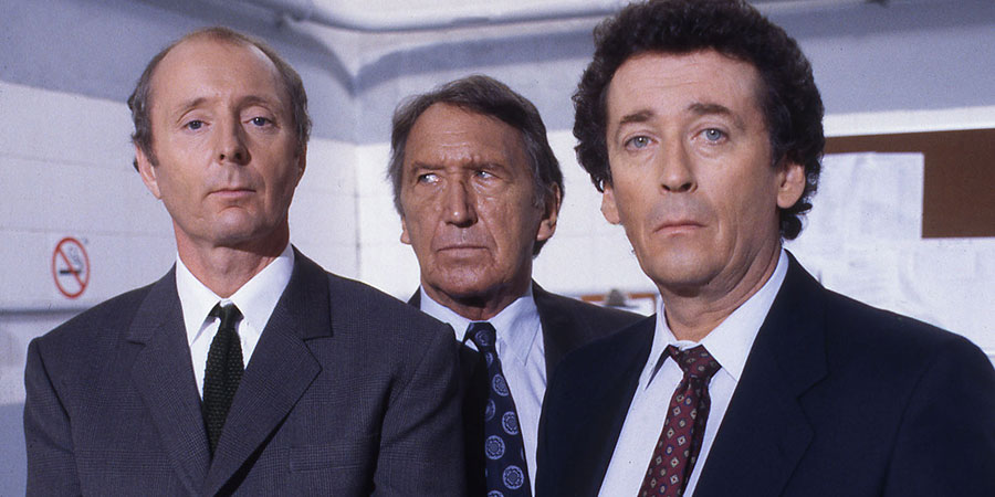The Detectives. Image shows from L to R: Dave Briggs (Robert Powell), Superintendent Cottam (George Sewell), Bob Louis (Jasper Carrott), Bob Louis (Jasper Carrott), Superintendent Cottam (George Sewell), Dave Briggs (Robert Powell). Copyright: Celador Productions.