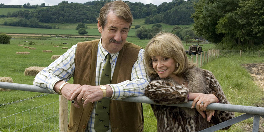 The Green Green Grass. Image shows from L to R: Boycie (John Challis), Marlene Boyce (Sue Holderness). Copyright: Shazam Productions.