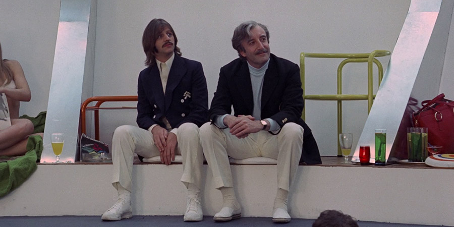 The Magic Christian. Image shows from L to R: Youngman Grand (Ringo Starr), Sir Guy Grand (Peter Sellers). Copyright: Universal Pictures.
