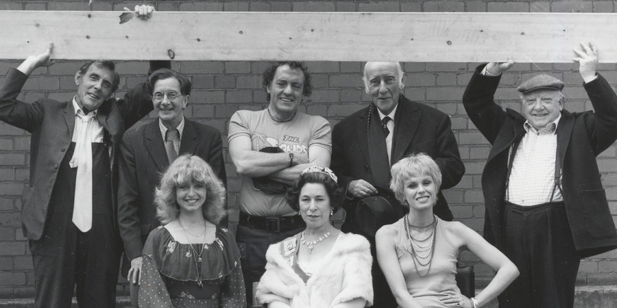 Photograph courtesy of Revelation Films. Image shows from L to R: Larger Workman (Eric Sykes), Amorous van driver's mate (Charles Hawtrey), Girl not crossing road (Liza Goddard), Amorous van driver (Harry H. Corbett), Unknown, Old man (Wilfrid Hyde-White), Hitch-hiker (Joanna Lumley), Smaller Workman (Arthur Lowe). Copyright: Thames Television.