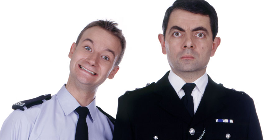 The Thin Blue Line. Image shows from L to R: P.C. Goody (James Dreyfus), Inspector Fowler (Rowan Atkinson). Copyright: Tiger Aspect Productions.